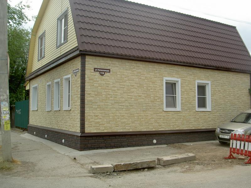 Отделка фасадными панелями коттеджа