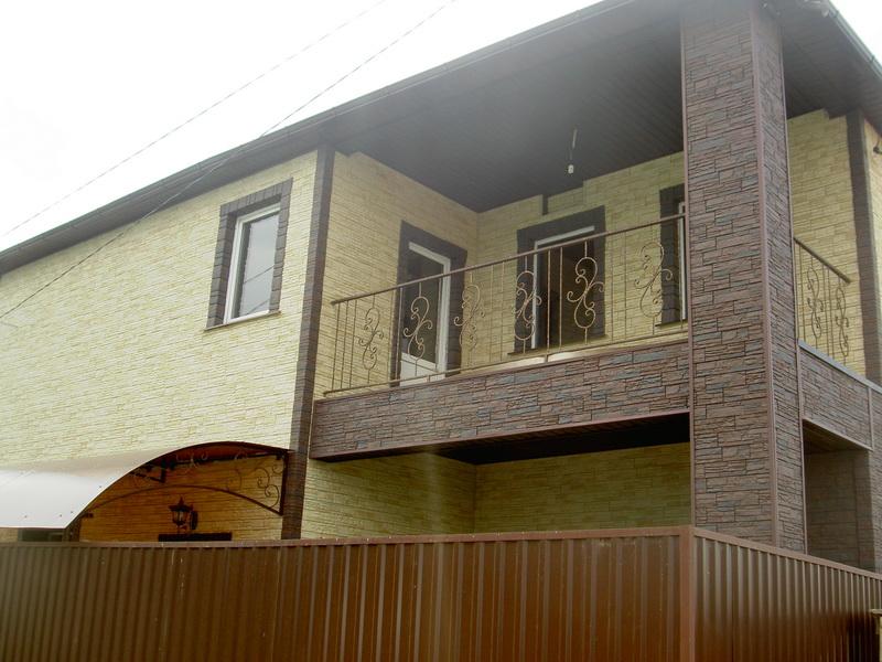 Отделка фасадными панелями дома
